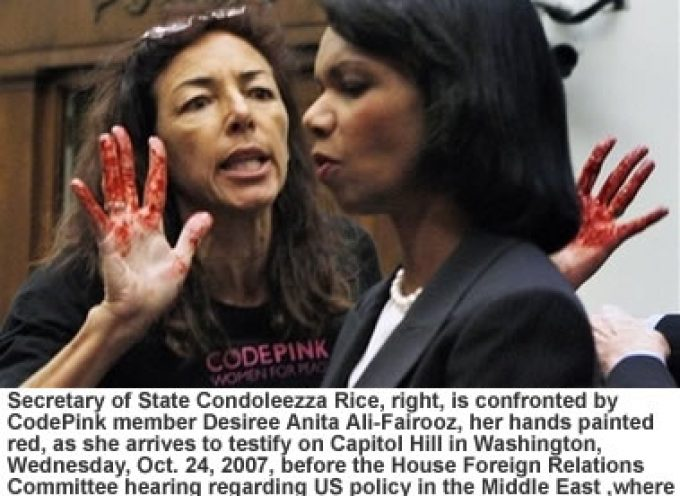 Protester Waves Blood-Colored Hands in Rice's Face