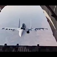 Close escort of a cargo plane plays game of peek-a-boo after cargo drop