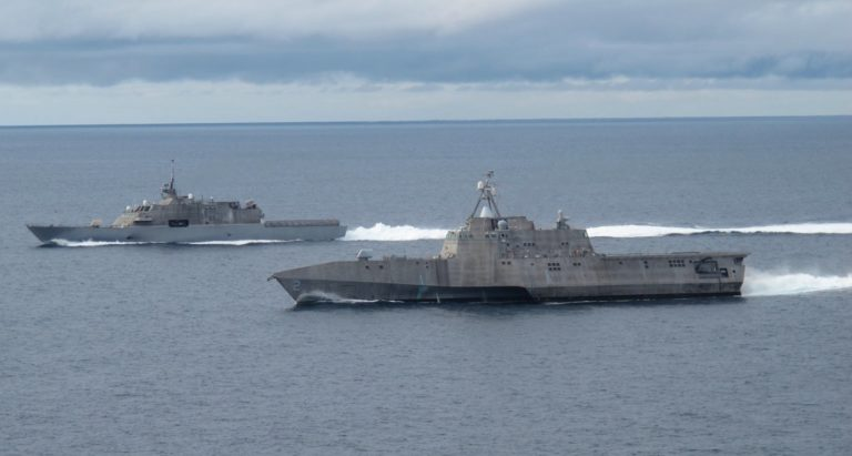 Freedom Class LCS (background) and Independence Class LCS (foreground). Arguably two of the most monumental failures of warship design in modern history. A cautionary tale of waste and ineptitude.