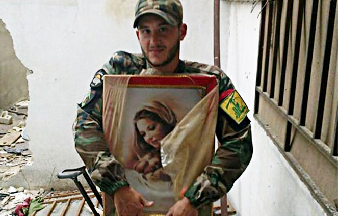 Hezbollah fighter with an image of the Holy Theotokos