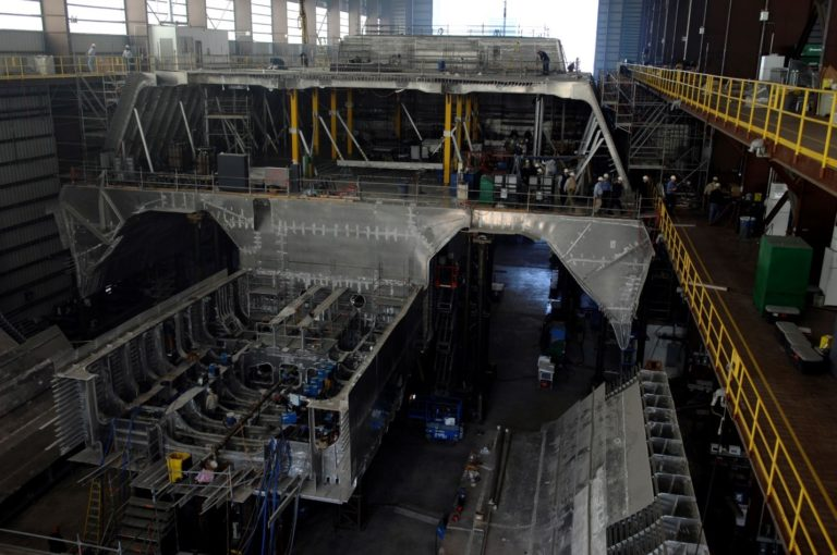 This image of the construction of USS Independence LCS-2, clearly illustrates the aluminum structure of the hull. Aluminum offers little armored protection, burns vigorously at high temperature, and led to increased corrosion of steal propulsion components in areas where the dissimilar metals were in close proximity below the waterline.