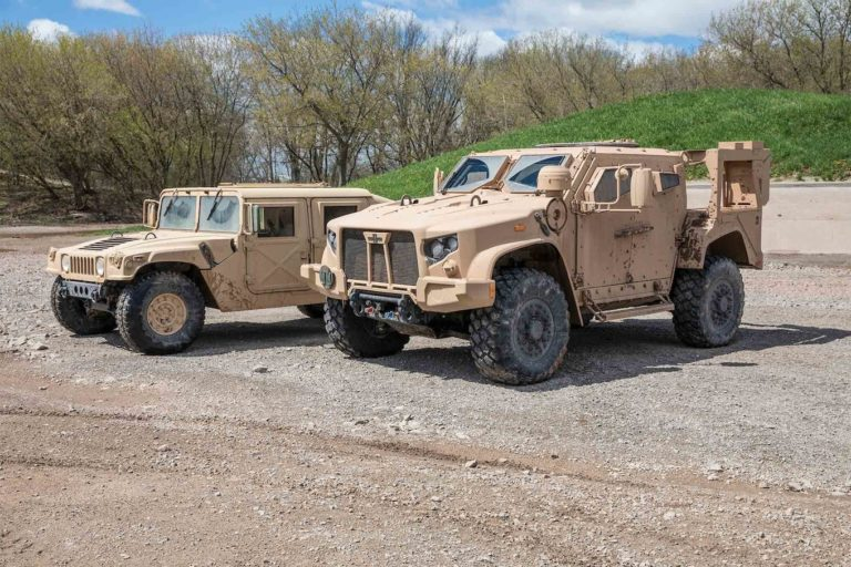 A side-by-side comparison of an unarmored HMMWV and an armored JLTV. The new vehicle is twice as heavy as the standard HMMWV.